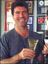 simon-with-champagne-in-office.jpg